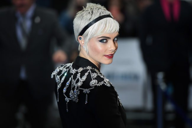 "TOPSHOT - British model and actress Cara Delevingne poses for a photograph upon arrival for the European premiere of ""Valerian and The City of a Thousand Planets"" in London on July 24, 2017. / AFP PHOTO / Chris J Ratcliffe        (Photo credit should read CHRIS J RATCLIFFE/AFP/Getty Images)"