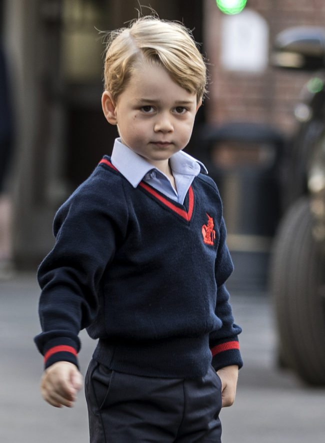 TOPSHOT - Britain's Prince George arrives for his first day of school at Thomas's school in Battersea, southwest London on September 7, 2017. / AFP PHOTO / POOL / RICHARD POHLE (Photo credit should read RICHARD POHLE/AFP/Getty Images)
