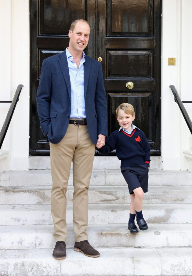 """LONDON, ENGLAND - SEPTEMBER 07: (In this handout photo released by the Duke and Duchess of Cambridge) Prince William, the Duke of Cambridge with his son Prince George on his first day of school on September 7, 2017 in London, England. The picture was taken at Kensington Palace in London shortly before Prince George left for his first day of school at Thomas's Battersea. Photographer Chris Jackson who took the picture said """"The first day of school is an exciting time for any child, and it was great to see Prince George with a big smile on his face next to Dad, The Duke of Cambridge, ahead of their first school run together."""" (Photo by Chris Jackson/Getty Images) NEWS EDITORIAL USE ONLY. NO COMMERCIAL USE (including any use in merchandising, advertising or any other non-editorial use including, for example, calendars, books and supplements). This photograph is provided to you strictly on condition that you will make no charge for the supply, release or publication of it and that these conditions and restrictions will apply (and that you will pass these on) to any organisation to whom you supply it. All other requests for use should be directed to the Press Office at Kensington Palace in writing."""