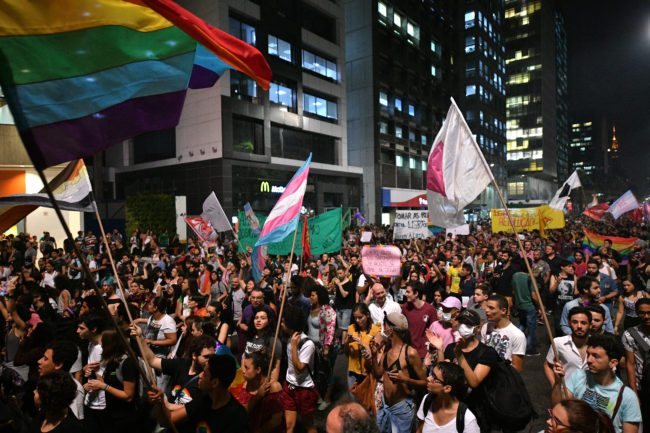People protest against the decision of a Brazilian judge who approved gay conversion therapy in Sao Paulo, Brazil on September 22, 2017. Brazilian federal judge Waldemar de Carvalho overruled a 1999 decision by the Federal Council of Psychology that forbade psychologists from offering widely discredited treatments which claims to cure gay people. / AFP PHOTO / NELSON ALMEIDA (Photo credit should read NELSON ALMEIDA/AFP/Getty Images)