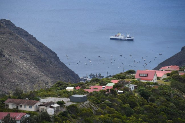 "JAMESTOWN, SAINT HELENA - OCTOBER 27:  The RMS ""St Helena"" sails in the harbour on October 26, 2017 in Jamestown, Saint Helena. Following the introduction of weekly flights to the island, resident St Helenians, known locally as ""Saints"", are preparing for a potential influx of tourists and investment as well as enjoying the possibilities brought by much faster transport links with South Africa. Previously, travel to the island involved travelling for a week by the Royal Mail Ship (RMS) ""Saint Helena"" from Cape Town. Saint Helena is a 46 square mile island in the South Atlantic which has been under British control since 1834.  (Photo by Leon Neal/Getty Images)"