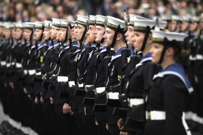 Members of the ship's company are seen during the Commissioning Ceremony for the Royal Navy aircraft carrier HMS Queen Elizabeth on board the ship at HM Naval Base in Portsmouth, southern England on December 7, 2017.  Her Majesty The Queen, accompanied by Her Royal Highness The Princess Royal, attended the Commissioning Ceremony of the aircraft carrier HMS Queen Elizabeth, the largest warship ever built for the Royal Navy.  / AFP PHOTO / POOL / Chris Jackson        (Photo credit should read CHRIS JACKSON/AFP/Getty Images)