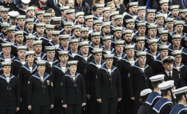Naval ratings stand to attention during the Commissioning Ceremony for the Royal Navy aircraft carrier HMS Queen Elizabeth at HM Naval Base in Portsmouth, southern England on December 7, 2017.  Her Majesty The Queen, accompanied by Her Royal Highness The Princess Royal, attended the Commissioning Ceremony of the aircraft carrier HMS Queen Elizabeth, the largest warship ever built for the Royal Navy.  / AFP PHOTO / POOL / RICHARD POHLE        (Photo credit should read RICHARD POHLE/AFP/Getty Images)