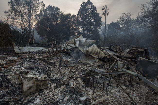 CARPINTERIA, CA - DECEMBER 10:  The ruins of a house that was destroyed by the Thomas Fire are seen on December 10, 2017 near Carpinteria, California. The Thomas Fire has grown to 173,000 acres and destroyed at least 754 structures so far. Strong Santa Ana winds have been feeding major wildfires all week, destroying houses and forcing tens of thousands of people to evacuate.  (Photo by David McNew/Getty Images)