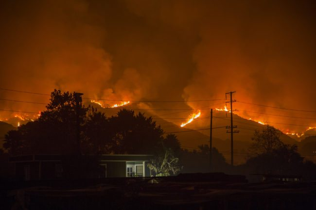 CARPINTERIA, CA - DECEMBER 10: The growing Thomas Fire advances toward Santa Barbara County seaside communities on December 10, 2017 in Carpinteria, California. The Thomas Fire has grown to 173,000 acres and destroyed at least 754 structures so far. Strong Santa Ana winds have been feeding major wildfires all week, destroying houses and forcing tens of thousands of people to evacuate.  (Photo by David McNew/Getty Images)