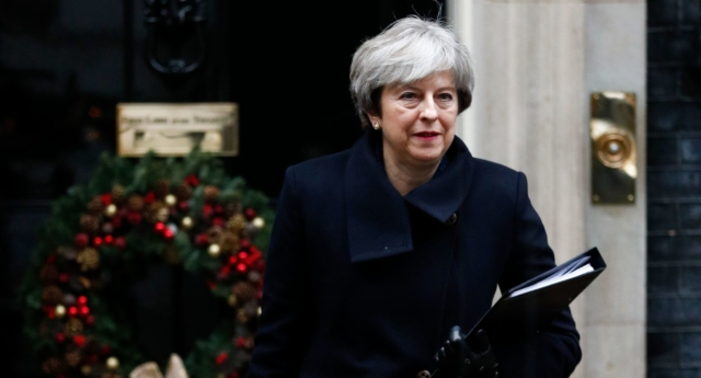 PM Theresa May (Photo by ADRIAN DENNIS/AFP/Getty Images)
