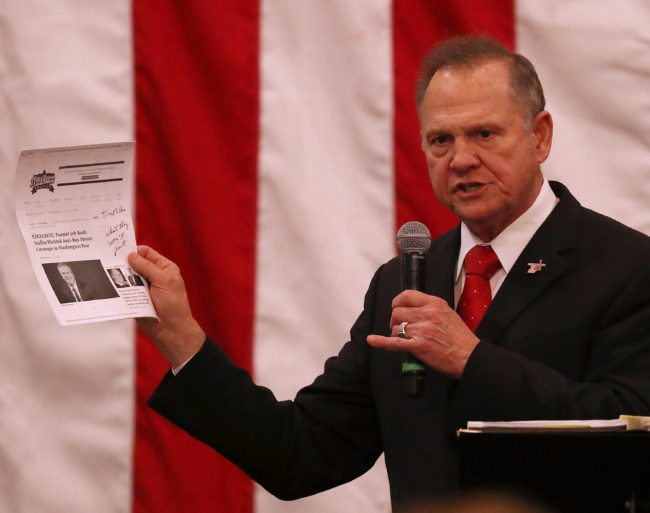 MIDLAND CITY, AL - DECEMBER 11:  Republican Senatorial candidate Roy Moore holds up a print out of a news story as he speaks during a campaign event at Jordan's Activity Barn on December 11, 2017 in Midland City, Alabama. Mr. Moore is facing off against Democrat Doug Jones in tomorrow's special election for the U.S. Senate.  (Photo by Joe Raedle/Getty Images)