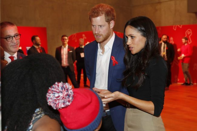 Prince Harry and his fiancee US actress Meghan Markle visit the Terrence Higgins Trust World AIDS Day charity fair (Getty)