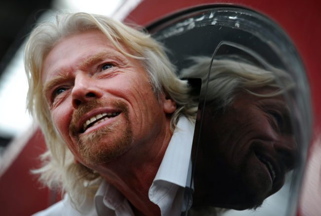 British entrepreneur Sir Richard Branson leans out of the window of the drivers cab on board a Virgin Pendolino train at Lime Street Station in Liverpool, north-west England, on March 13, 2012, as he prepares to launch a Global Entrepreneurship Congress. The event aims to be the largest gathering of start-up champions from around the world. AFP PHOTO/PAUL ELLIS (Photo credit should read PAUL ELLIS/AFP/Getty Images)