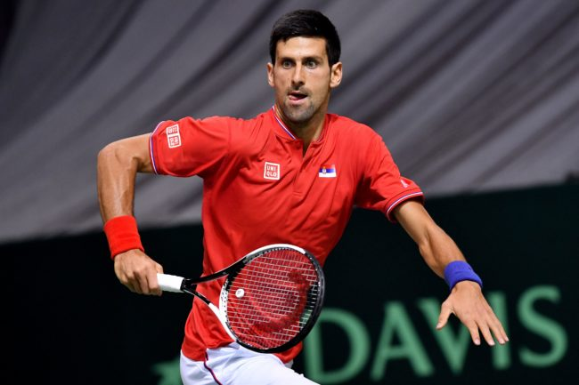 Serbia's Novak Djokovic runs to return the ball to Russia's Daniil Medvedev during the Davis Cup World Group first round singles tennis match between Serbia and Russia at Cair sports hall in Nis, on February 3, 2017. / AFP / ANDREJ ISAKOVIC (Photo credit should read ANDREJ ISAKOVIC/AFP/Getty Images)