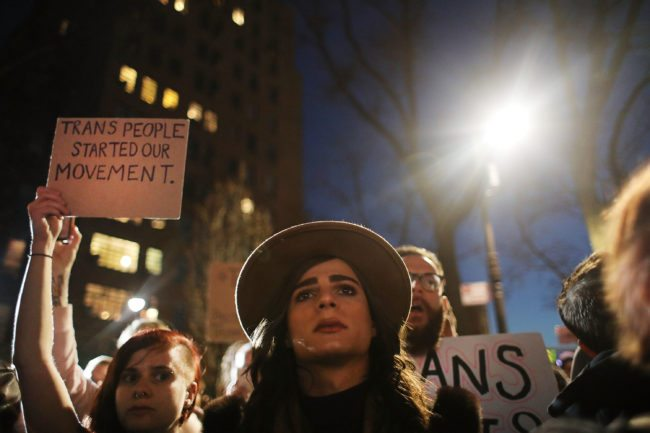 NEW YORK, NY - FEBRUARY 23:  Hundreds protest a Trump administration announcement this week that rescinds an Obama-era order allowing transgender students to use school bathrooms matching their gender identities, at the Stonewall Inn on February 23, 2017 in New York City. Activists and members of the transgender community gathered outside the historic LGTB bar to denounce the new policy.  (Photo by Spencer Platt/Getty Images)