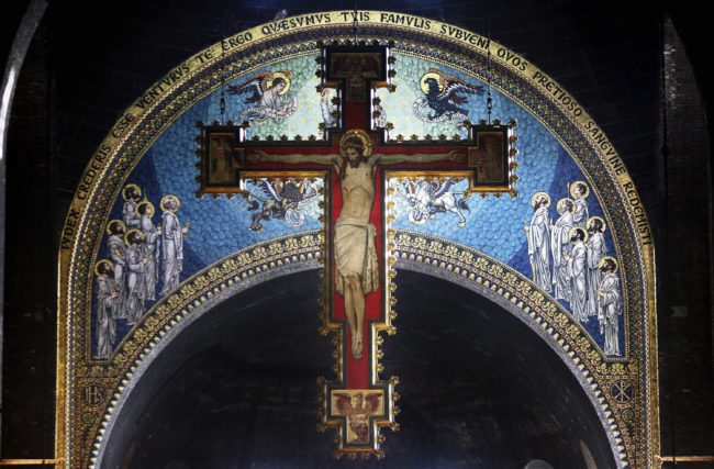 A cross with a painting of Jesus Christ (Photo by Peter Macdiarmid/Getty Images)
