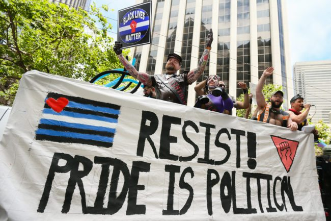 SAN FRANCISCO, CA - JUNE 25: A man holds a 'Black Lives Matter' sign while participating in the annual LGBTQI Pride Parade on June 25, 2017 in San Francisco, California. The LGBT community descended on Market Street for the 47th annual Pride Parade  (Photo by Elijah Nouvelage/Getty Images)