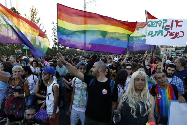 Participants attend the annual Jerusalem Gay Pride Parade on August 3, 2017.  / AFP PHOTO / Gali TIBBON        (Photo credit should read GALI TIBBON/AFP/Getty Images)
