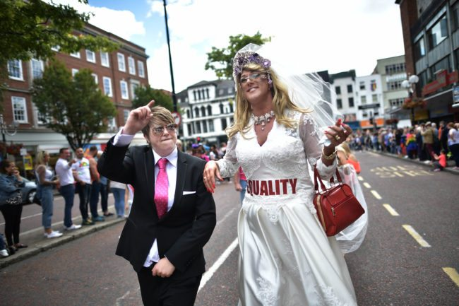 BELFAST, NORTHERN IRELAND - AUGUST 05: A drag queen and a participant dressed as Donald Trump wave to the cowd as Belfast Gay Pride takes place on August 5, 2017 in Belfast, Northern Ireland. The province is the only part of the United Kingdom which does not recognise same sex marriage. The Irish Republic's first gay prime minister Taoiseach Leo Varadkar today predicted it is only a matter of time before same sex marriage is legalised in the north. Mr Varadkar was speaking at a Pride breakfast event. (Photo by Charles McQuillan/Getty Images)