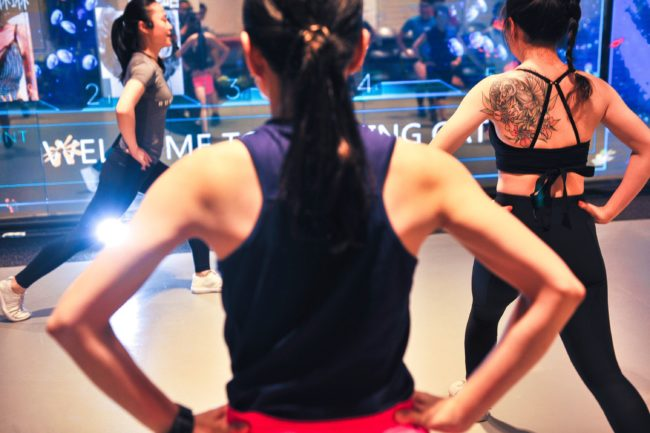 This photo taken on July 28, 2017 shows runners training in a gym in Shanghai. A growing number of young, educated, urban Chinese are shrugging off the myriad hazards to keep fit through serious running and the number of marathons and running events in the country is mushrooming. / AFP PHOTO / STR / China OUT / TO GO WITH AFP STORY LIFESTYLE-CHINA-RUNNING-HEALTH-POLLUTION,FEATURE BY PETER STEBBINGS (Photo credit should read STR/AFP/Getty Images)