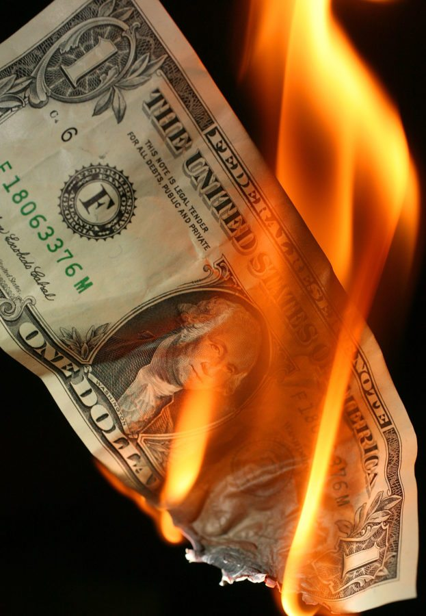 MANCHESTER, UNITED KINGDOM - OCTOBER 24:  In this photo illustration, an America one USD note burns on October 24, 2008 in Manchester, England. As markets across the globe continue to struggle, the world wide credit crunch begins to bite deeper with fears of economic recession  (Photo by Christopher Furlong/Getty Images)