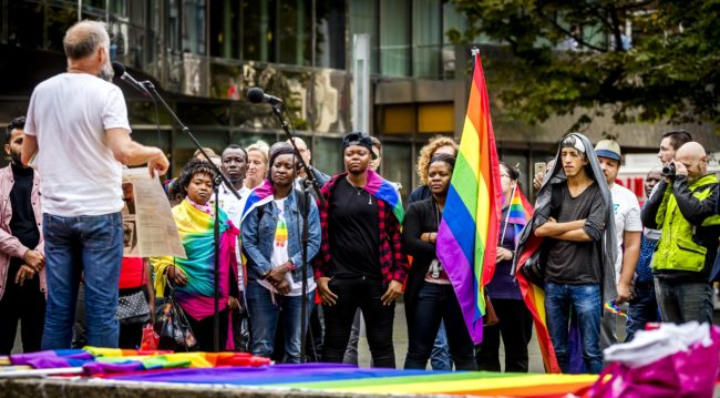 Members of the LGBT (lesbian, gay, bisexual, and transgender) community who are also migrants or refugees, demonstrate to demand better recognition in The Hague, on September 5, 2017. / AFP PHOTO / ANP / Remko DE WAAL / Netherlands OUT (Photo credit should read REMKO DE WAAL/AFP/Getty Images)