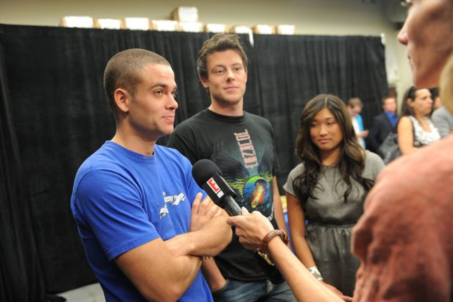 """LOS ANGELES, CA - NOVEMBER 07: (L-R) Actors Mark Salling, Jenna Ushkowitz and Cory Monteith give an interview as the cast of """"Glee"""" signs copies of """"Glee: The Music Vol. 1"""" at Barnes & Noble bookstore at The Grove on November 7, 2009 in Los Angeles, California. (Photo by Jordan Strauss/Getty Images for Columbia Records)"""