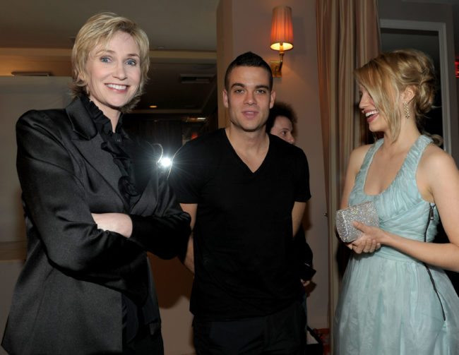 WEST HOLLYWOOD, CA - JANUARY 09: (L-R) Actress Jane Lynch, actor Mark Salling, and actress Dianna Agron attend the celebration of Glee's Golden Globe nominations with InStyle and 20th Century Fox held at Sunset Tower on January 9, 2010 in West Hollywood, California. (Photo by Michael Buckner/Getty Images for InStyle)