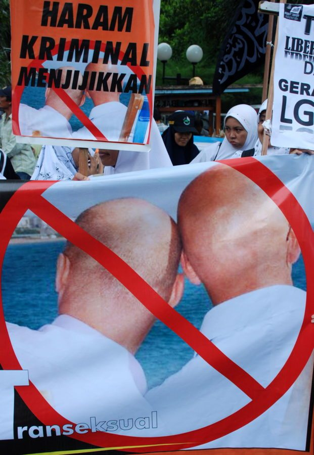 Indonesian Muslim protestors of Muslim organization 'Hizbuth Tahrir' hold a banner reading, 'Forbidden, Crime and Disgusting' refering to Lesbian, Gay, Bisexual and Transexual associations during a protest against an eventual meeting on the issue in Surabaya on March 26, 2010. Indonesian police said on March 24, they will not issue a permit for an international gay and transgender group to convene a regional conference because of fears it could incite unrest. The international lesbian, gay, bisexual, transgender and intersex association (ILGA) was scheduled to meet from 26 - 28 March in the world's most populous Muslim country. AFP PHOTO / MUHAMMAD RISYAL HIDAYAT (Photo credit should read MUHAMMAD RISYAL HIDAYAT/AFP/Getty Images)