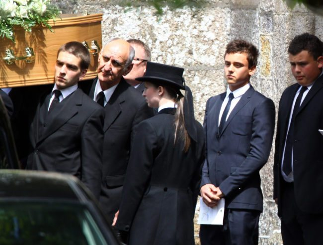 PLYMPTON, ENGLAND - JUNE 08:  Tom Daley, (second from right) follows the coffin carrying his father, Robert Daley as it leaves St. Mary's Church on June 8, 2011 in Plympton, England. British diving champion Tom Daley's father, Rob, who was 40, died on 27 May after a long battle with brain cancer.  (Photo by Matt Cardy/Getty Images)