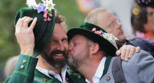 Two men in tradinitonal Bavarian clothing participate in the annual Christopher Street Day Parade celebrating LGBT rights (Photo Getty Images)