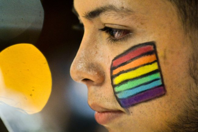 A Colombian LGBT community member takes part in a rally on June 15, 2016, in Cali, Colombia, in solidarity with the victims of the Orlando mass shooting.  / AFP / LUIS ROBAYO        (Photo credit should read LUIS ROBAYO/AFP/Getty Images)