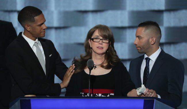 PHILADELPHIA, PA - JULY 27:  Christine Leinonen, mother of Christopher 'Dru' Leinonen, is comforted by Brandon Wolf (L) and Jose Arriagada (R), survivors of the attack at the Pulse nightclub in Orlando, as they stand on stage during the third day of the Democratic National Convention at the Wells Fargo Center, July 27, 2016 in Philadelphia, Pennsylvania. Democratic presidential candidate Hillary Clinton received the number of votes needed to secure the party's nomination. An estimated 50,000 people are expected in Philadelphia, including hundreds of protesters and members of the media. The four-day Democratic National Convention kicked off July 25.  (Photo by Alex Wong/Getty Images)