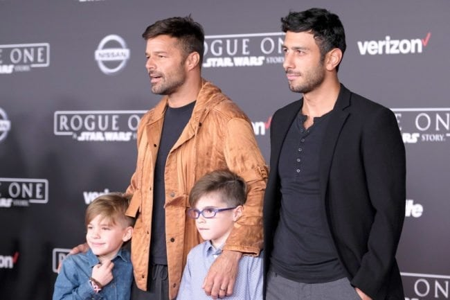"HOLLYWOOD, CA - DECEMBER 10: Musician Ricky Martin and Jwan Yosef (top L-R) and Valentino Martin and Matteo Martin attend the premiere of Walt Disney Pictures and Lucasfilm's ""Rogue One: A Star Wars Story"" at the Pantages Theatre on December 10, 2016 in Hollywood, California. (Photo by Frazer Harrison/Getty Images)"