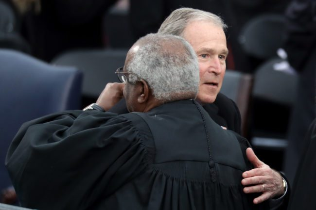 WASHINGTON, DC - JANUARY 20:  Former President George W. Bush (R) greets Supreme Court Justice Clarence Thomas on the West Front of the U.S. Capitol on January 20, 2017 in Washington, DC. In today's inauguration ceremony Donald J. Trump becomes the 45th president of the United States.  (Photo by Chip Somodevilla/Getty Images)