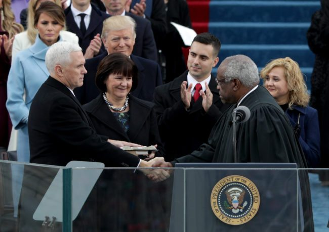 WASHINGTON, DC - JANUARY 20:  Vice President Mike Pence shakes hands with Supreme Court Justice Clarence Thomas as wife Karen Pence holds a bible on the West Front of the U.S. Capitol on January 20, 2017 in Washington, DC. In today's inauguration ceremony Donald J. Trump becomes the 45th president of the United States.  (Photo by Alex Wong/Getty Images)
