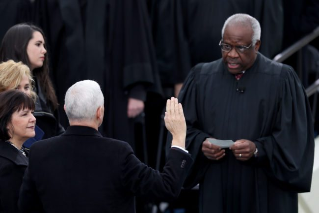 WASHINGTON, DC - JANUARY 20:  Vice President Mike Pence takes the oath of office from Supreme Court Clarence Thomas as wife Karen Pence holds a bible on the West Front of the U.S. Capitol on January 20, 2017 in Washington, DC. In today's inauguration ceremony Donald J. Trump becomes the 45th president of the United States.  (Photo by Joe Raedle/Getty Images)