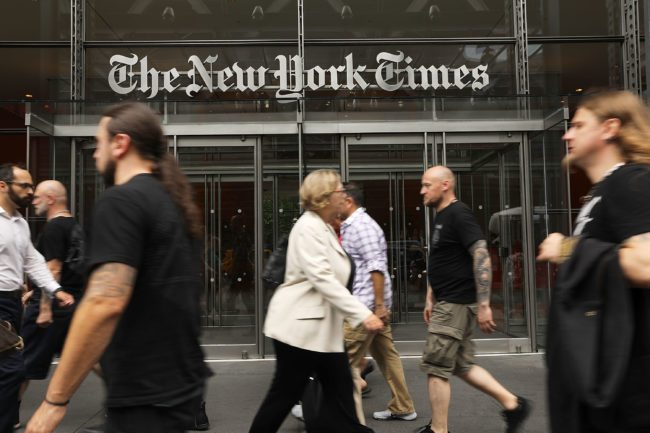 NEW YORK, NY - JULY 27:  People walk past the New York Times building on July 27, 2017 in New York City.  The New York Times Company shares have surged to a nine-year high after posting strong earnings on Thursday. Partly due to new digital subscriptions following the election of Donald Trump as president, the company reported a profit of $27.7 million in the second quarter, up from $9.1 million in the same period last year.  (Photo by Spencer Platt/Getty Images)