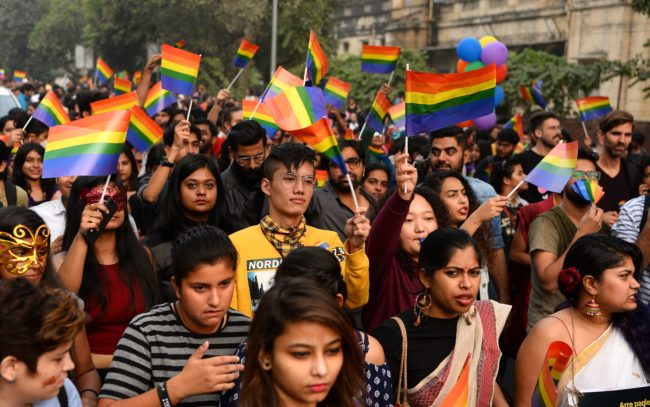 Indian members and supporters of the lesbian, gay, bisexual, transgender (LGBT) community take part in a pride parade in New Delhi on November 12, 2017. Hundreds of members of the LGBT community marched through the Indian capital for the 10th annual Delhi Queer Pride Parade. / AFP PHOTO / SAJJAD HUSSAIN (Photo credit should read SAJJAD HUSSAIN/AFP/Getty Images)