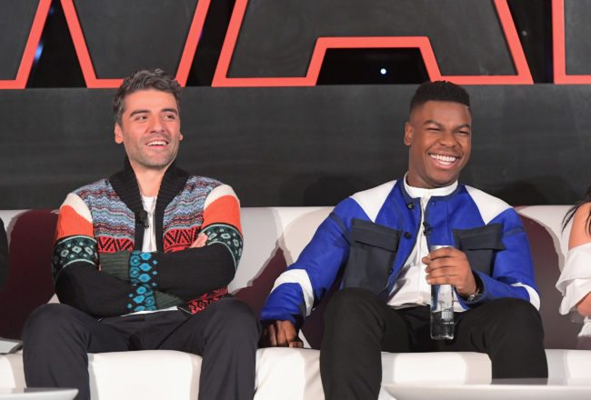 LOS ANGELES, CA - DECEMBER 03: Actors Oscar Isaac (L) and John Boyega attend the press conference for the highly anticipated Star Wars: The Last Jedi at InterContinental Los Angeles on December 3, 2017 in Los Angeles, California.  (Photo by Charley Gallay/Getty Images for Disney )