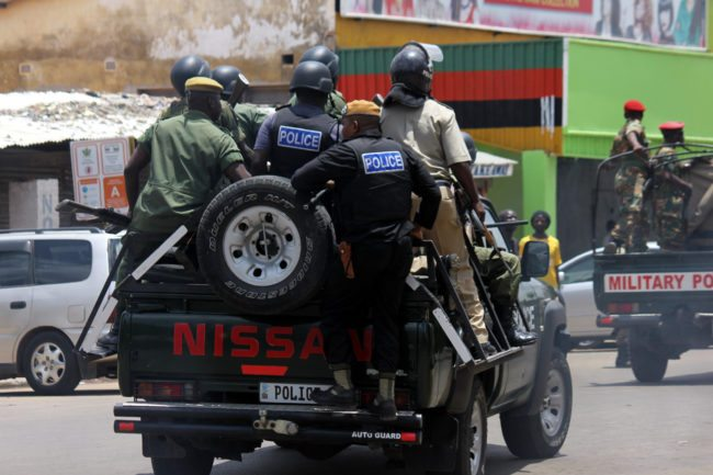 Zambian riot police officers patrol in the streets of Lusaka, on January 15, 2018, during march of Zambian traders and vendors to protest over a ban on street commerce aimed at curbing a deadly cholera outbreak. Police in Zambia's capital Lusaka fired tear gas at angry traders marching to the president's office. The 500-strong crowd was trying to deliver a petition to President Edgar Lungu who has become the public face of the campaign against the outbreak that has claimed at least 70 lives since September. Authorities have banned several street markets in Lusaka in an effort to reduce the volume of food and drink sold in unsanitary open-air locations, which are particularly vulnerable to the spread of cholera. / AFP PHOTO / DAWOOD SALIM (Photo credit should read DAWOOD SALIM/AFP/Getty Images)