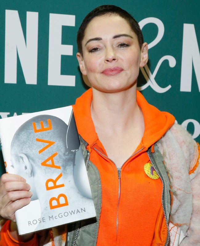"""NEW YORK, NY - JANUARY 31: Rose McGowan signs copies of her memoir """"Brave"""" at Barnes & Noble Union Square on January 31, 2018 in New York City. (Photo by John Lamparski/Getty Images)"""