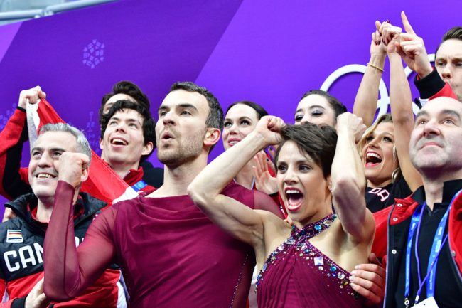 Canada's Meagan Duhamel (centre R) and Canada's Eric Radford (centre L) react after competing in the figure skating team event pair skating free skating during the Pyeongchang 2018 Winter Olympic Games at the Gangneung Ice Arena in Gangneung on February 11, 2018. / AFP PHOTO / Mladen ANTONOV (Photo credit should read MLADEN ANTONOV/AFP/Getty Images)