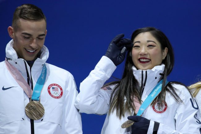 PYEONGCHANG-GUN, SOUTH KOREA - FEBRUARY 12: Bronze medalists Adam Rippon (L) and Mirai Nagasu of Team United States celebrate during the victory ceremony after the Figure Skating Team Event at Medal Plaza on February 12, 2018 in Pyeongchang-gun, South Korea. (Photo by Andreas Rentz/Getty Images)