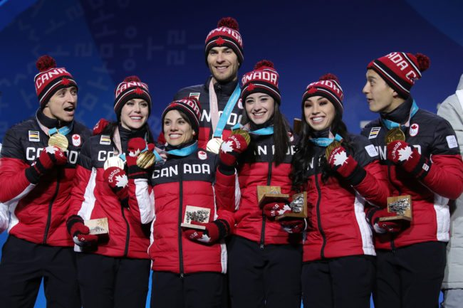 PYEONGCHANG-GUN, SOUTH KOREA - FEBRUARY 12: Gold medalists (L-R) Scott Moir, Tessa Virtue, Meagan Duhamel, Eric Radford, Kaetlyn Osmond, Gabrielle Daleman, and Patrick Chan of Team Canada celebrate during the medal ceremony after the Figure Skating Team Event at Medal Plaza on February 12, 2018 in Pyeongchang-gun, South Korea. (Photo by Andreas Rentz/Getty Images)