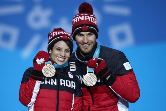 PYEONGCHANG-GUN, SOUTH KOREA - FEBRUARY 15: Bronze medalists Meagan Duhamel and Eric Radford of Canada celebrate during the medal ceremony for the Pair Skating Free Skating on day six of the PyeongChang 2018 Winter Olympic Games at Medal Plaza on February 15, 2018 in Pyeongchang-gun, South Korea. (Photo by Clive Mason/Getty Images)