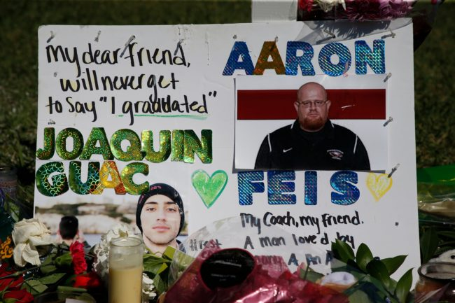 A memorial for student Joaquin Oliver and assistant football coach Aaron Feis, two of the victims of the Marjory Stoneman Douglas High School shooting, sits in a park in Parkland, Florida on February 16, 2018.   A former student, Nikolas Cruz, opened fire at the Florida high school leaving 17 people dead and 15 injured. / AFP PHOTO / RHONA WISE        (Photo credit should read RHONA WISE/AFP/Getty Images)