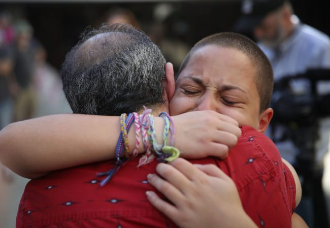 FORT LAUDERDALE, FL - FEBRUARY 17:  Emma Gonzalez hugs her father Jose Gonzalez as they join other people after a school shooting that killed 17 to protest against guns on the steps of the Broward County Federal courthouse on February 17, 2018 in Fort Lauderdale, Florida. Earlier this week former student Nikolas Cruz opened fire with a AR-15 rifle at the Marjory Stoneman Douglas High School killing 17 people.  (Photo by Joe Raedle/Getty Images)