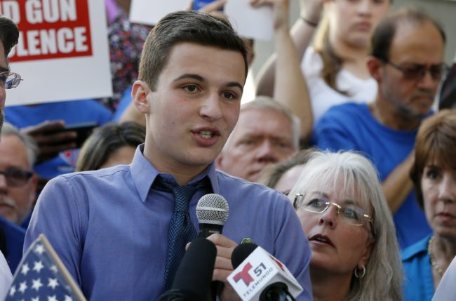 Marjory Stoneman Douglas High School student Cameron Kasky speaks at a rally for gun control at the Broward County Federal Courthouse in Fort Lauderdale, Florida on February 17, 2018.  Seventeen perished and more than a dozen were wounded in the hail of bullets at Marjory Stoneman Douglas High School in Parkland,Florida the latest mass shooting to devastate a small US community and renew calls for gun control. / AFP PHOTO / RHONA WISE        (Photo credit should read RHONA WISE/AFP/Getty Images)