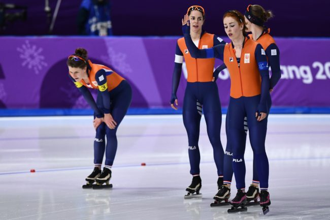 (L-R) Netherlands' Ireen Wust, Netherlands' Marrit Leenstra, Netherlands' Lotte van Beek and Netherlands' Antoinette De Jong react after the women's team pursuit final A speed skating event during the Pyeongchang 2018 Winter Olympic Games at the Gangneung Oval in Gangneung on February 21, 2018. / AFP PHOTO / ARIS MESSINIS        (Photo credit should read ARIS MESSINIS/AFP/Getty Images)