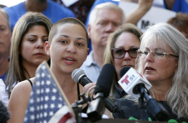 Marjory Stoneman Douglas High School student Emma Gonzalez is hugged by a friend following her speech at a rally for gun control at the Broward County Federal Courthouse in Fort Lauderdale, Florida on February 17, 2018. A former student, Nikolas Cruz, opened fire at the high school leaving 17 people dead and 15 injured on February 14. / AFP PHOTO / RHONA WISE (Photo credit should read RHONA WISE/AFP/Getty Images)