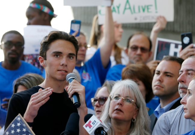 (FILES) File photo dated February 17, 2018 shows Marjory Stoneman Douglas High School student David Hogg speaking at a rally for gun control at the Broward County Federal Courthouse in Fort Lauderdale, Florida. A former student, Nikolas Cruz, opened fire at the high school leaving 17 people dead and 15 injured on February 14. / AFP PHOTO / RHONA WISE (Photo credit should read RHONA WISE/AFP/Getty Images)