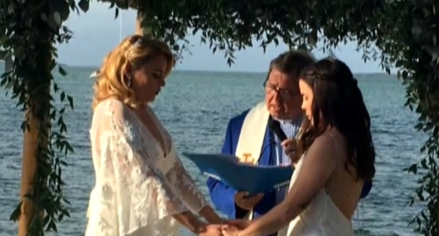 Teacher fired for posting pictures of her wedding online