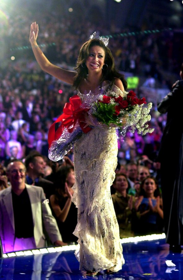 "ATLANTIC CITY, NJ - SEPTEMBER 22: Newly crowned Miss America 2003 Erika Harold reacts as she walks on the runway September 21, 2002 in Atlantic City, New Jersey. Harold's platform for her reign is Empowering Youth Against Violence: ""Respect Yourself: Protect Yourself."" (Photo by William Thomas Cain/Getty Images)"